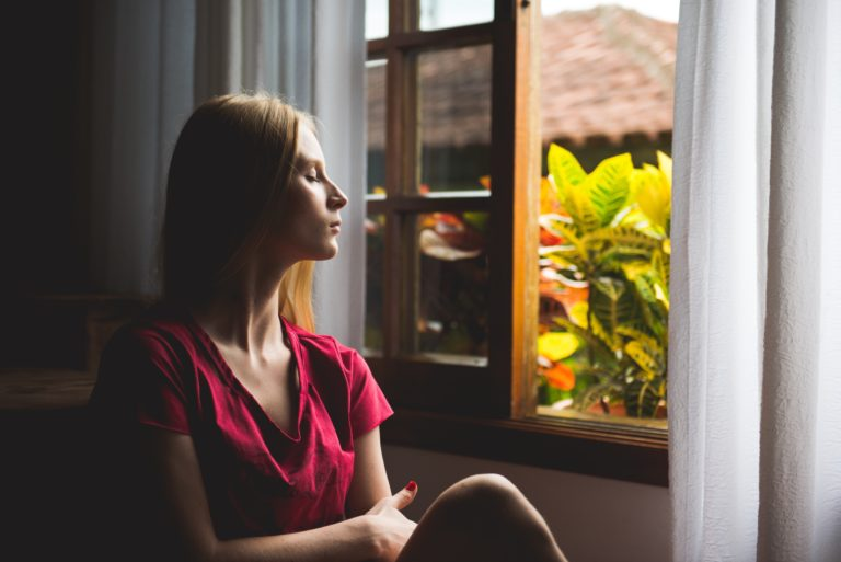 Woman staring out window
